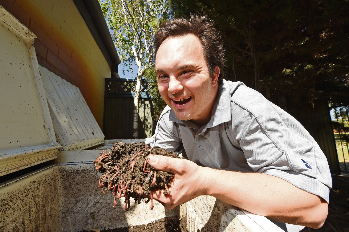 Shaun Amozig with some of the worms he cares for. Picture: Jon Hewson www.communitypix.com.au d476301