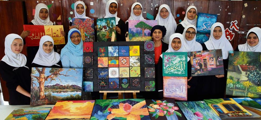 Principal Khurshida Islam and art teacher Amelia Joseph with Year 9 girls. Picture: Martin Kennealey www.communitypix.com.au d476315