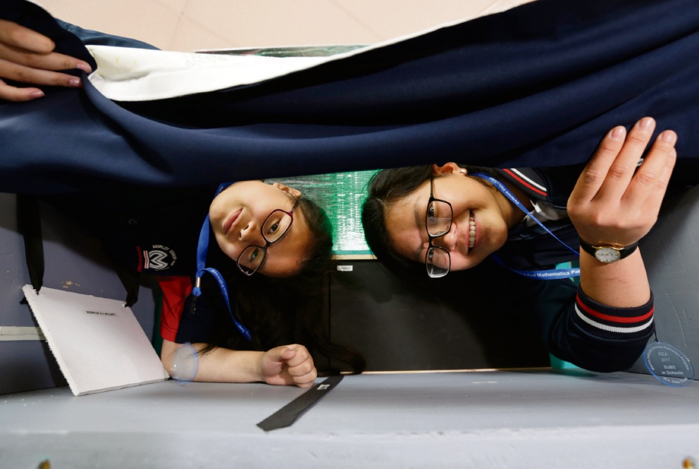 Jasmine Nguyen (Y7) and Uyen Nguyen (Y11) pictured with the prototype of a sleeping quarter of a submarine. Picture: Andrew Ritchie d476291