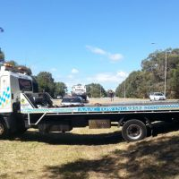 The tow truck became bogged after picking up a broken down car.