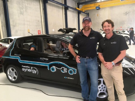 Synergy employees Glenn Elliott and Allen Gerber with the Synergy Nissan Leaf.