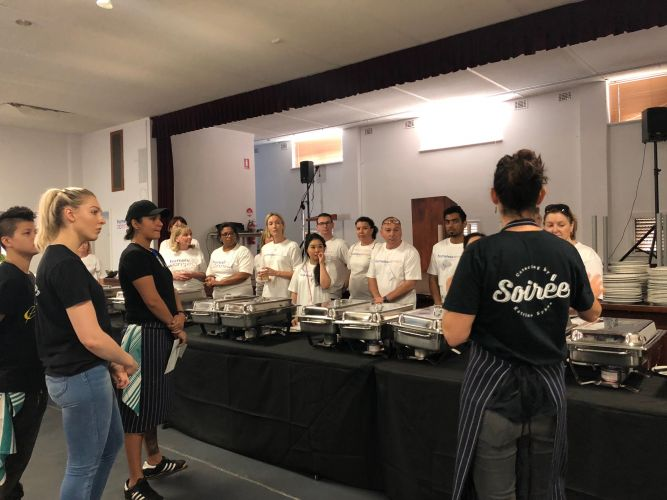 Dining room volunteers preparing to feed 2000 homeless people.