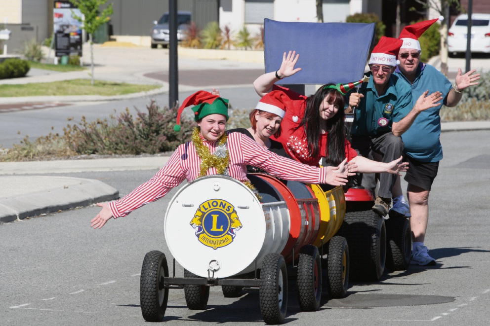 Christmas ride: Ruby Oliver, Jan Oliver, Suzanne Perry, Rob Longmire and Norm Pearson getting into the Christmas spirit with a train ride.  Picture: Bruce Hunt www.communitypix.com.au   d476131