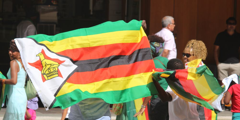Zimbabwe-born people gathered in Perth on Saturday with flags to support the campaign for change.