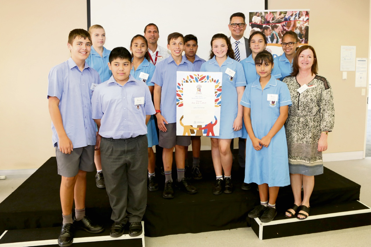 Lumen Christi students receiving their PALS program award with school Aboriginal liaison office Simon Wright (back left), Treasurer Ben Wyatt (back right) and Head of Arts Carmen Stewart (front right).