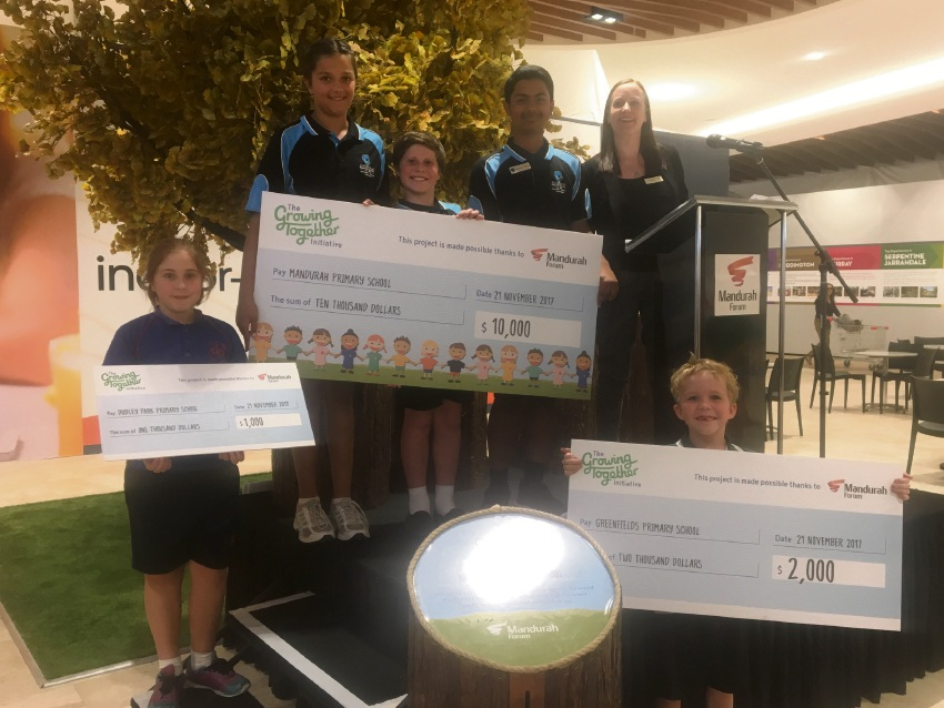 The winning schools with their cheques.