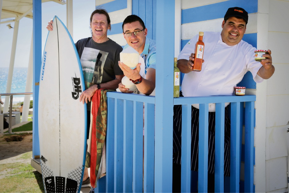 Scarborough Beach Association chairman Wayne Bowen, Coco Cabana's Reece Beazley and Canarian Cuisine's Francisco Bulido get excited for the Sunset Markets, to be held at Scarborough this year. Picture: Andrew Ritchie.