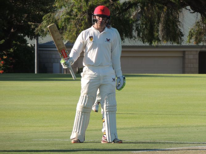 Perth batsman Hugh Sando raises the bat to celebrate after reaching 150.