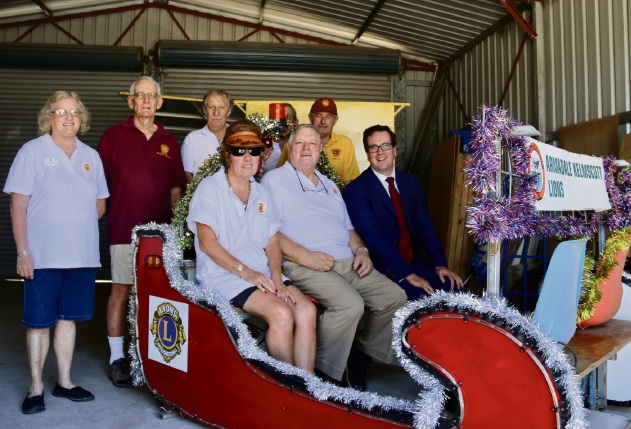 Representatives from the Armadale-Kelmscott Lions Club with MHR Matt Keogh in the Santa Sleigh.