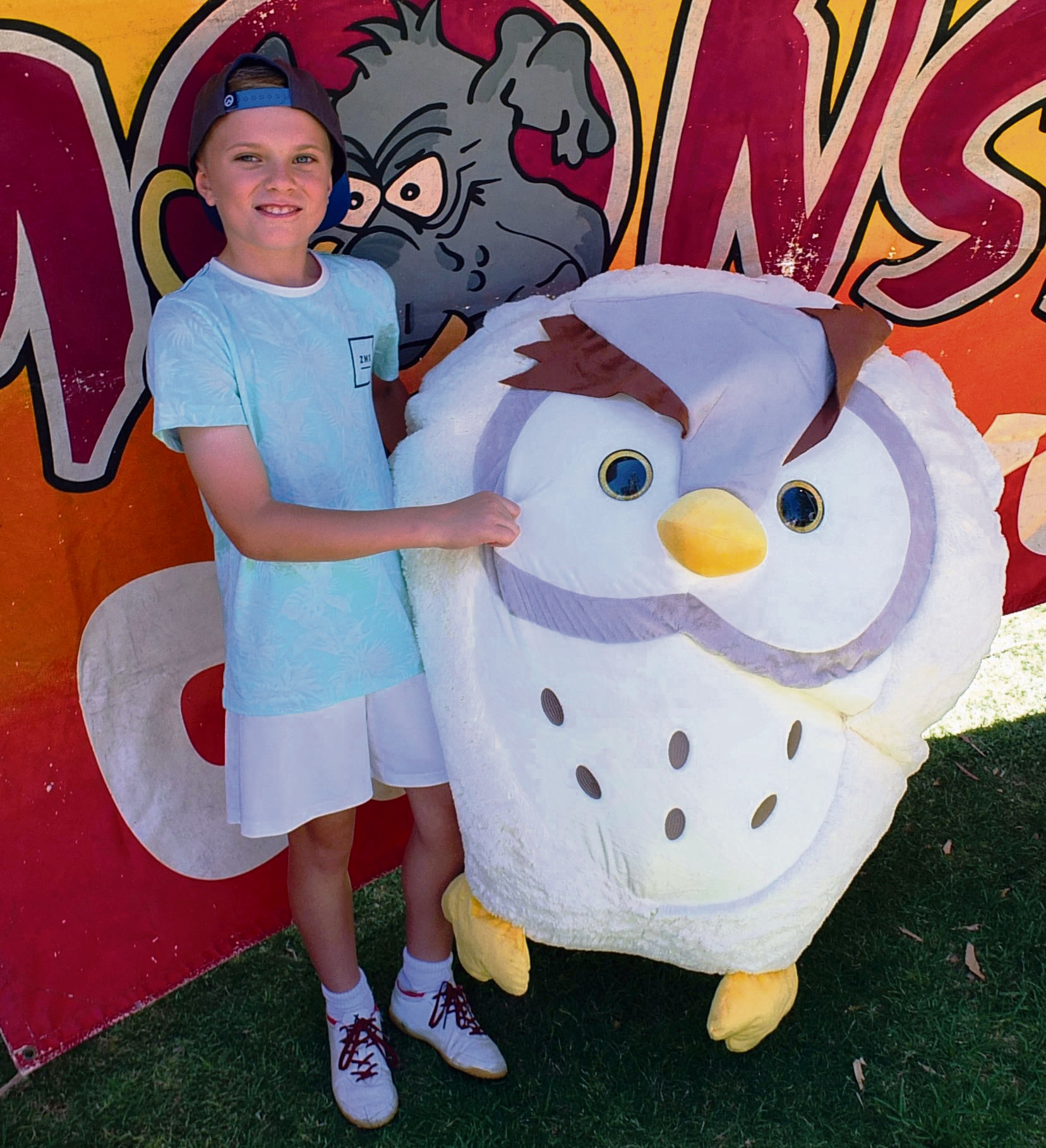 Pic 9 Kayden Harman (9) with a large owl won at a Side Show Alley stall.