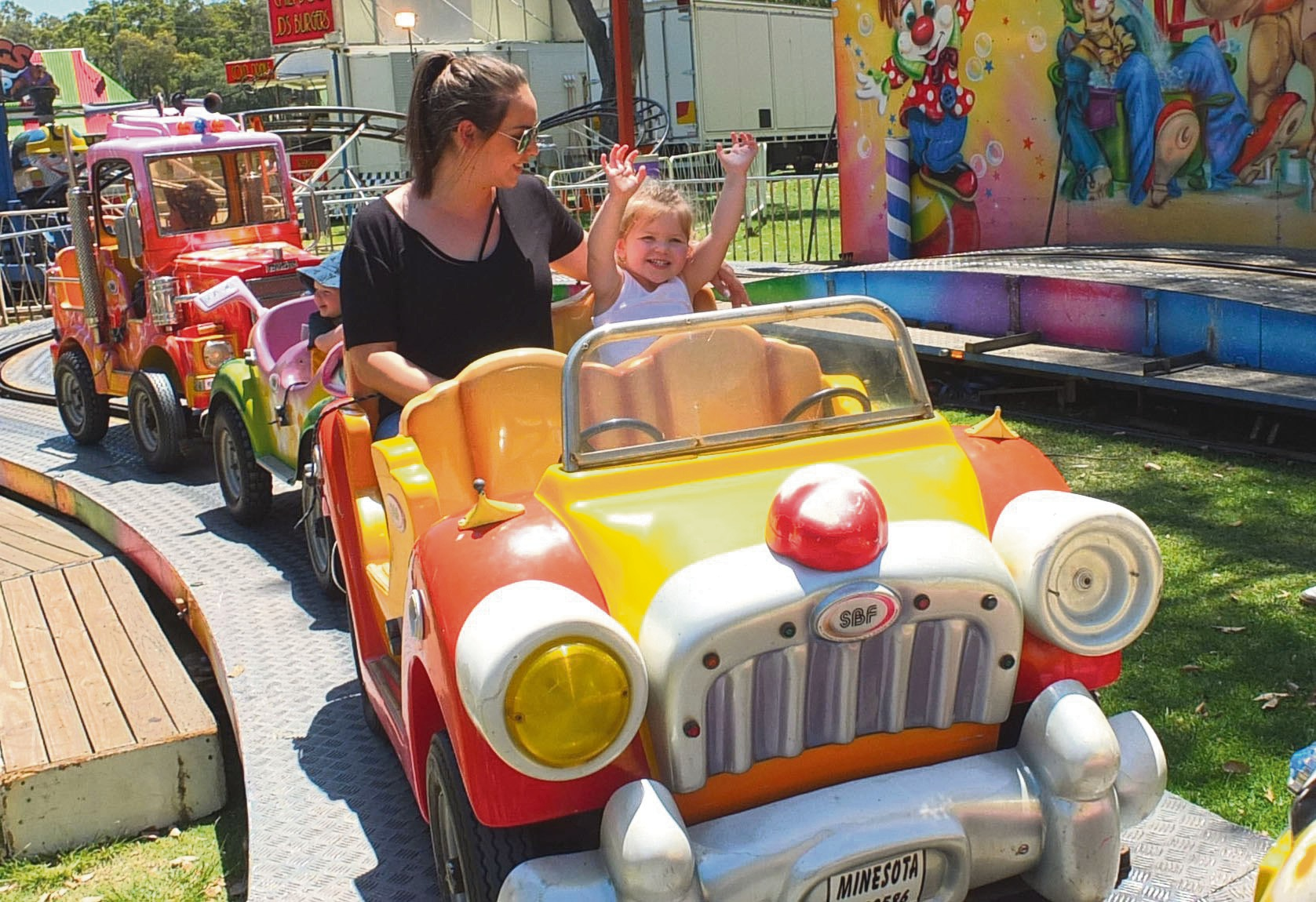 Emma Dyer with her daughter Billie (2) enjoy a ride at Side Show Alley.