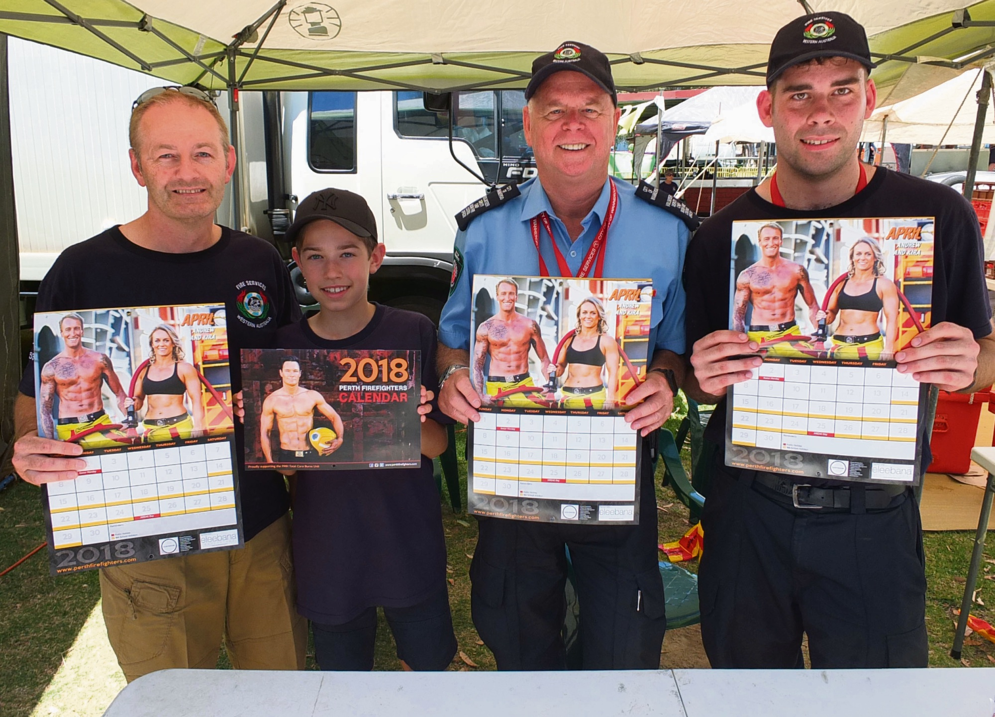 Wanneroo Central Bush Fire Brigade members Damian Duffy, Oliver Duffy, Stephen Foureur and Allan Mills with 2018 Perth Firefighters' Calendars.