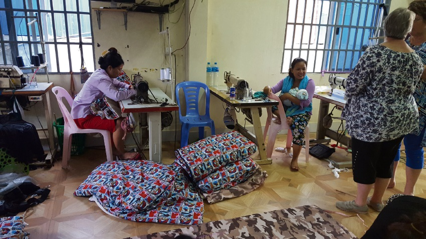 Cambodian workers in Phnom Penh sewing the sleeping bags.