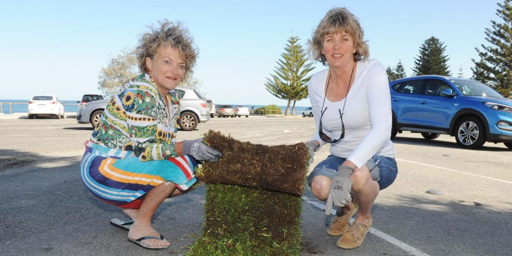 Cottesloe councillors Sandra Boulter and Sally Pyvis are looking forward to when grass covers even part of the decaying carpark at Cottesloe Beach. Picture: Jon Bassett