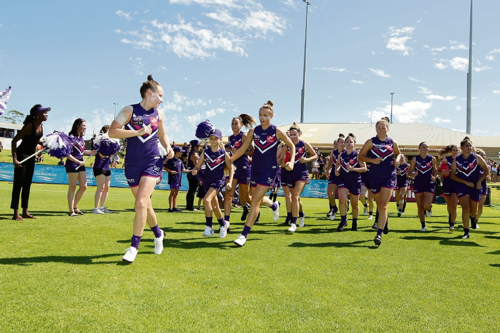 Kara Donnellan of the Dockers leads the team out during the round five AFL Women's match between the Fremantle and Collingwood. Picture: by Will Russell/AFL Media/Getty Images