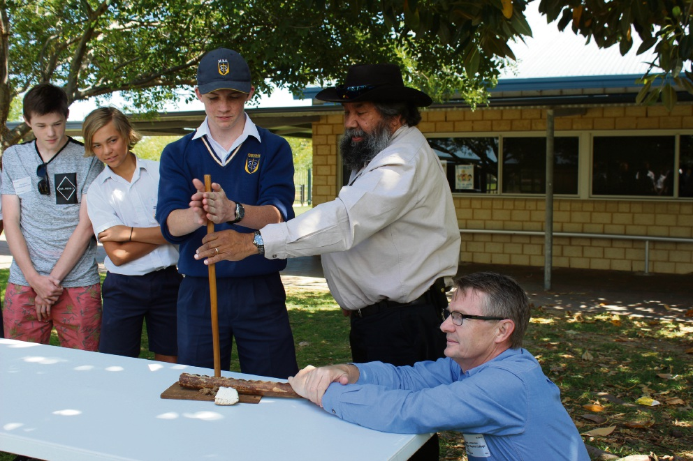 2016 Head boy Samuel Anderson, year eight student Seja McCarthy watching year eight student Lachlan Bridge trying to create smoke with the help of Aboriginal elder Koodah Cornwell and FISH chief executive Mark Anderson.