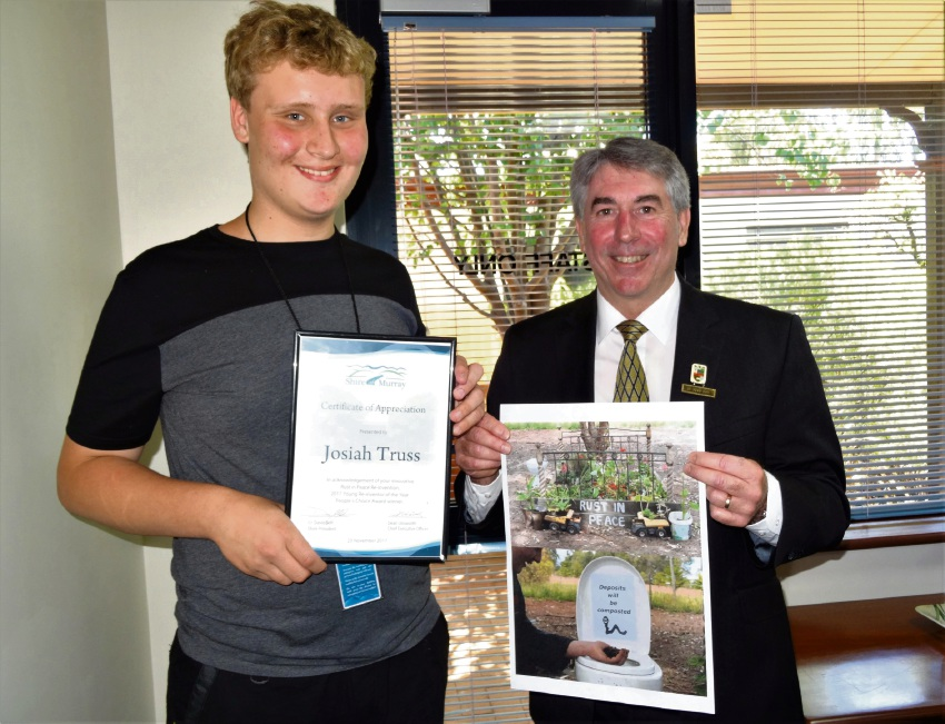 Competition winner Josiah Truss with Murray shire president David Bolt.