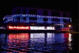 Port Mandurah Rotary wishing well decked with Christmas lights.