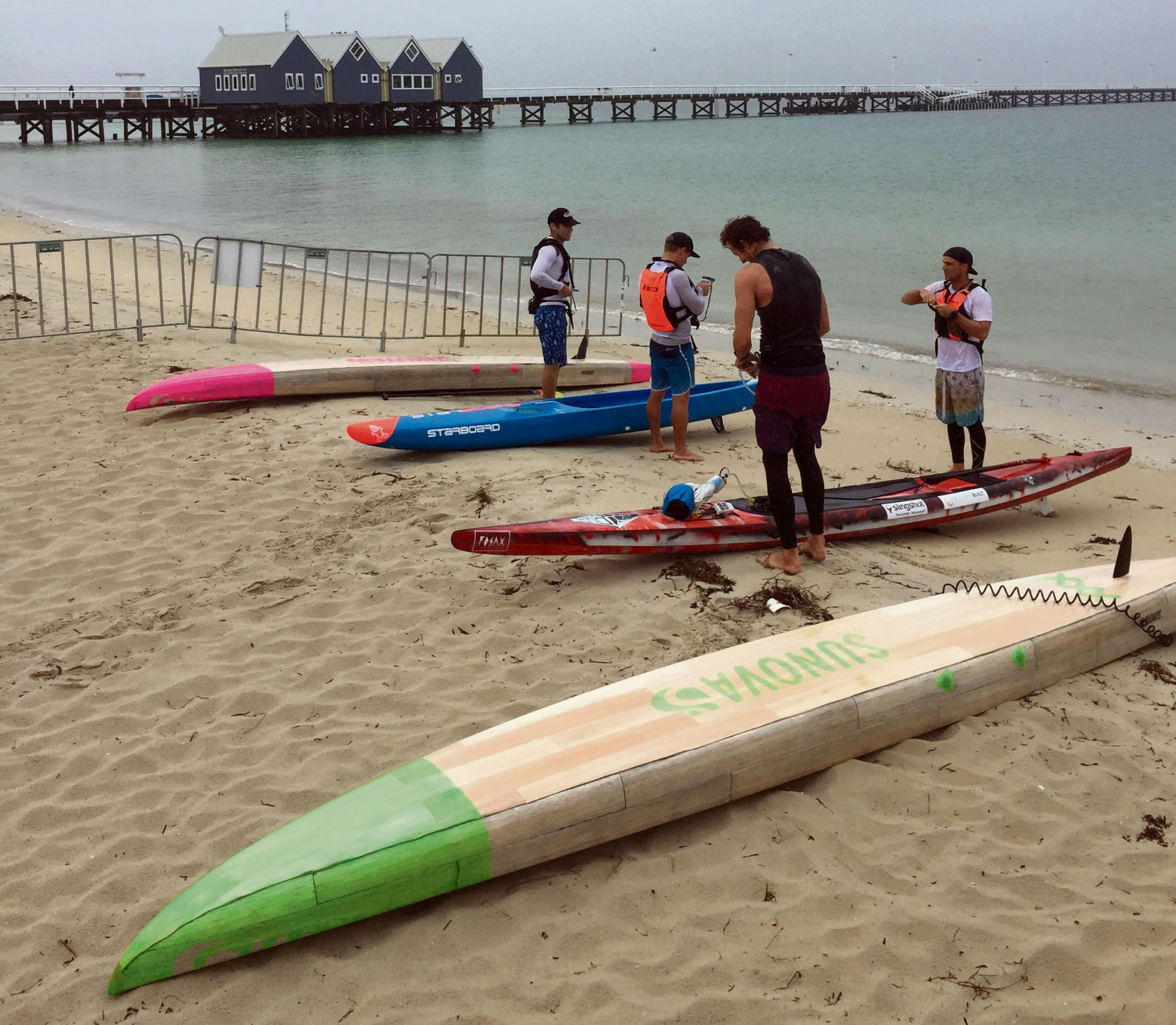 SUP boarders Cameron McKay, Luke Hallam, Michael Booth and Alex Fossiloi leave Busselton mid-way yesterday.