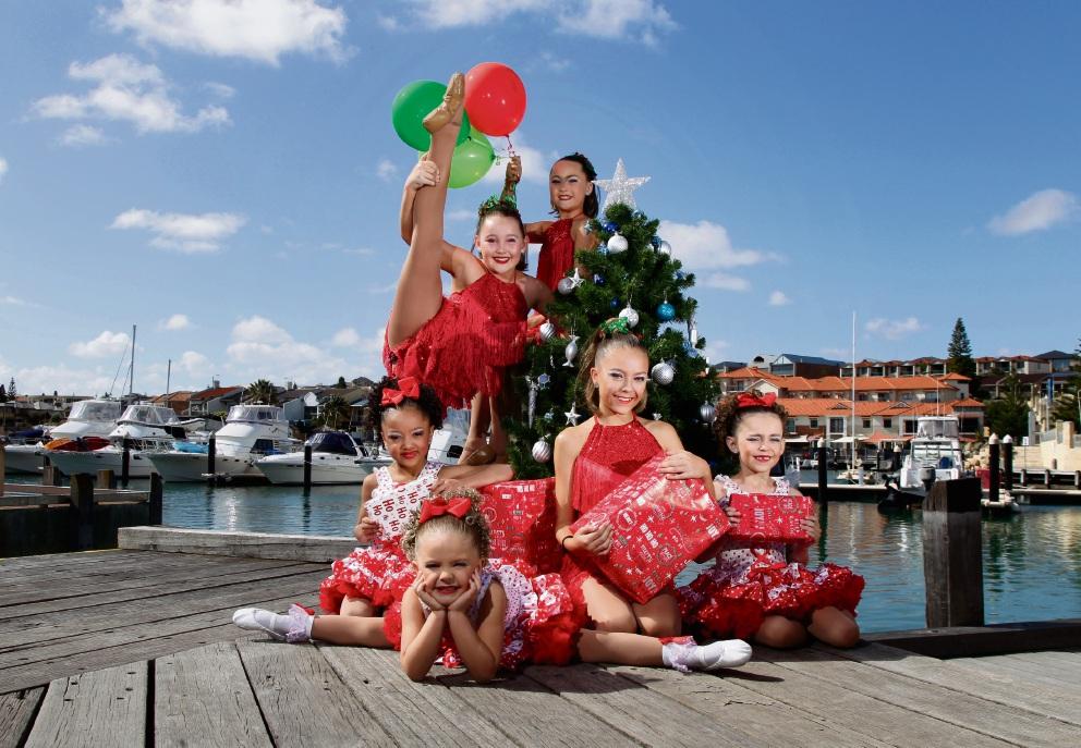 Girls from Impcact Dance Factory are getting excited about Mindarie Marina's Christmas Festival in December, where they will be performing. (L-R) back: Tahlia Thorpe (12), Mya Sabine (10). front: Serenity Bell (6), Kalia Bishop (5), Alexiar Bishop (11) and Elouise Keed (7). Picture: Marie Nirme d474337