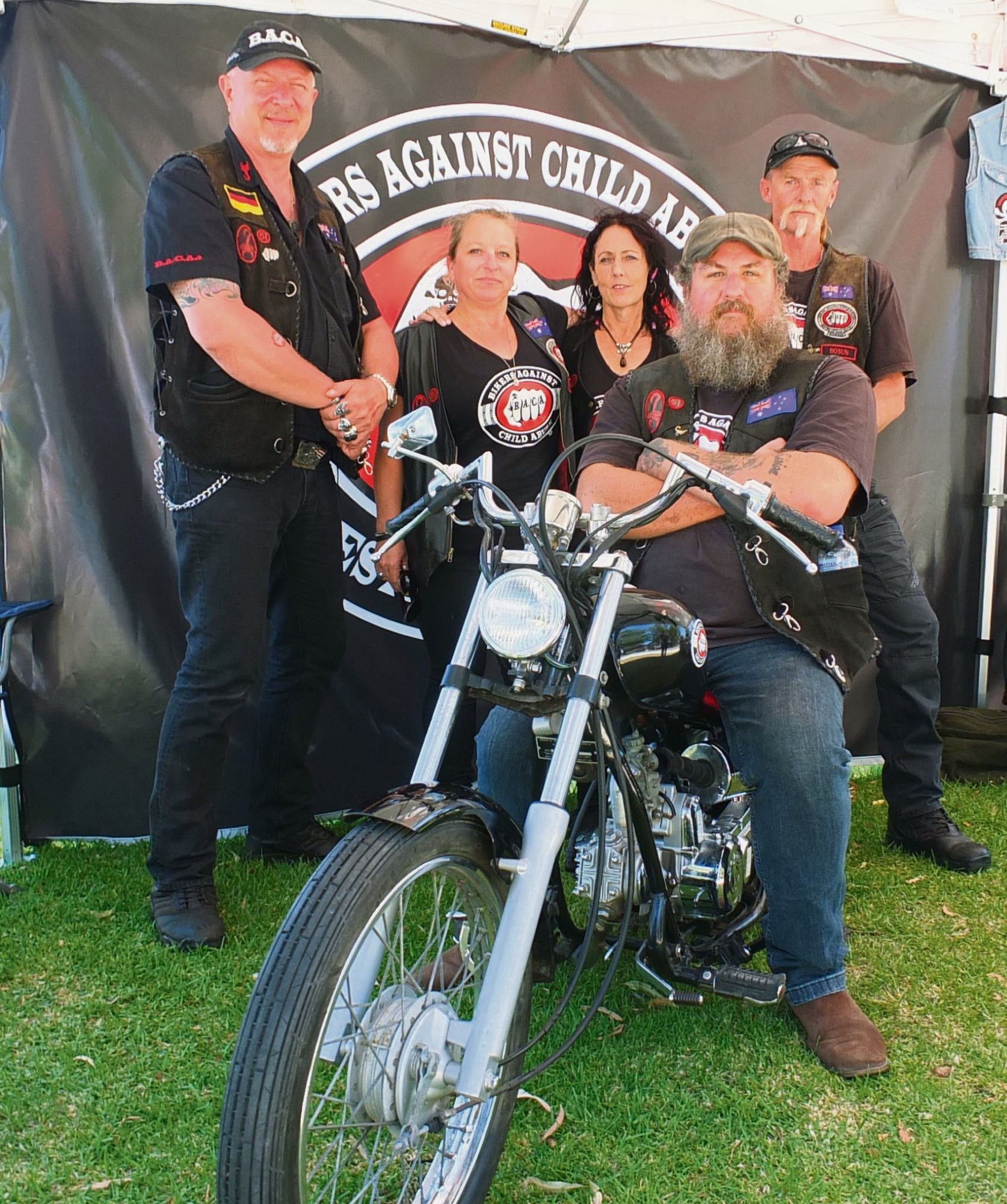BACA members at a stall at the Wanneroo Show. Pictured standing from left, are Dutch, Bootz, Staplz and Bosun, with Chib on a small motorbike.