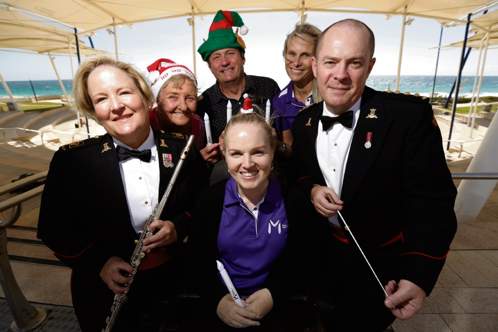 Wendy Kehoe (Australian Army Band Perth), Marlene Robins and Geoff Counsel both from the Scarborough Beach Association, with (front) Brianna O'Donnell (Muscular Dystrophy WA), Hayley Lethlean (Muscular Dystrophy WA) and Capt Matt O'Keeffe (Australian Army Band Perth). Picture: Andrew Ritchie d476759