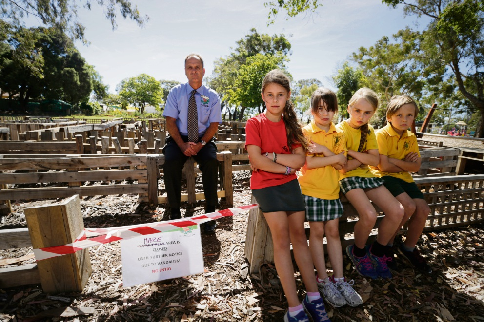 Newborough Primary School principal John Worthy with Year 3 students Jess Hadley, Candice Hewitt, Alex Otway and Jakob Kosok, who can't play in the playground because vandals have wrecked it. Picture: Andrew Ritchie www.communitypix.com.au   d477025