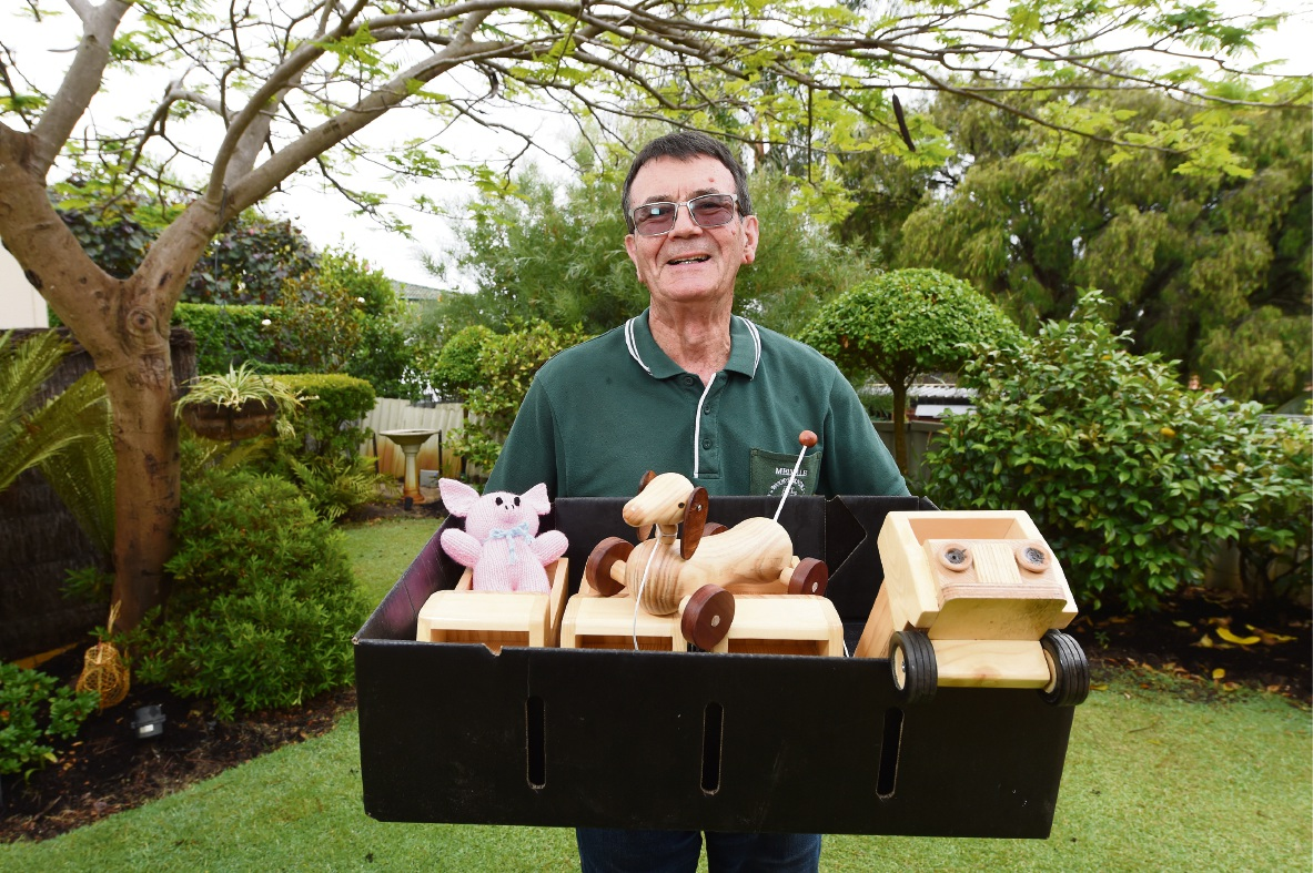 Melville Woodturners Group convenor Bernard Boycott with some of the toys that will be donated to MercyCare, Parkerville Children and Youth Care and Wanslea Family Services on Wednesday.