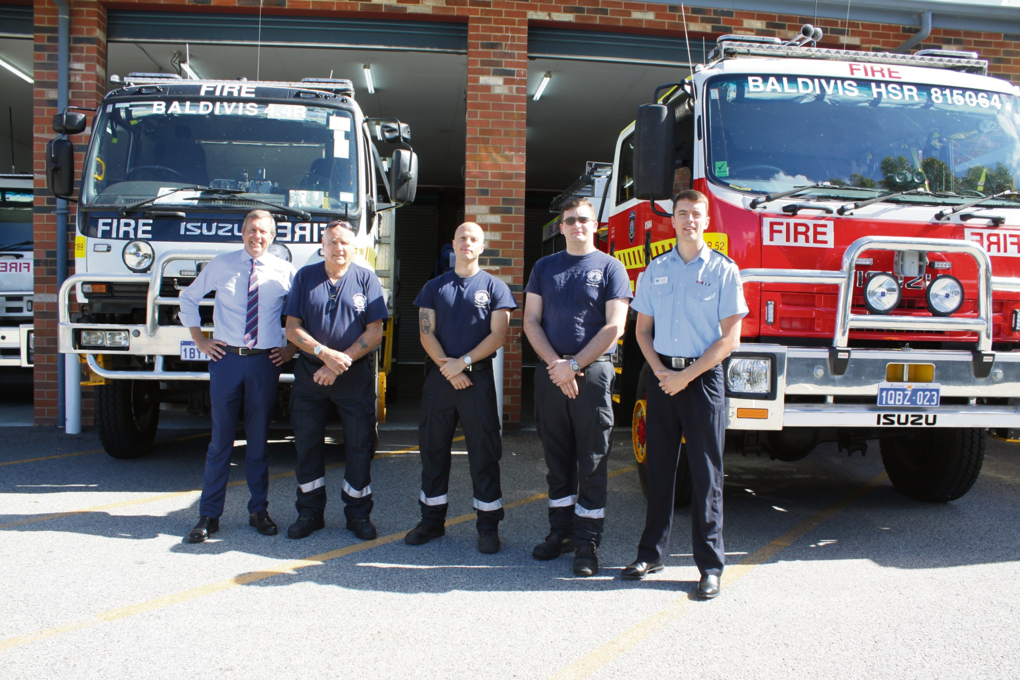 Baldivis MLA Reece Whitby with firefighters Graham Oliver, Aaron Higgins, Lewis Ascough and Tyler Winter.