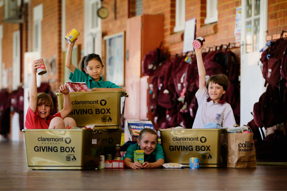 Connor Johnson, Val Wong, Isabelle Criddle and Thomas Grist, Year 3 kids from Dalkeith Primary who have been collecting donations to help Anglicare and Foodbank WA over Christmas. Picture: Andrew Ritchie www.communitypix.com.au d477053