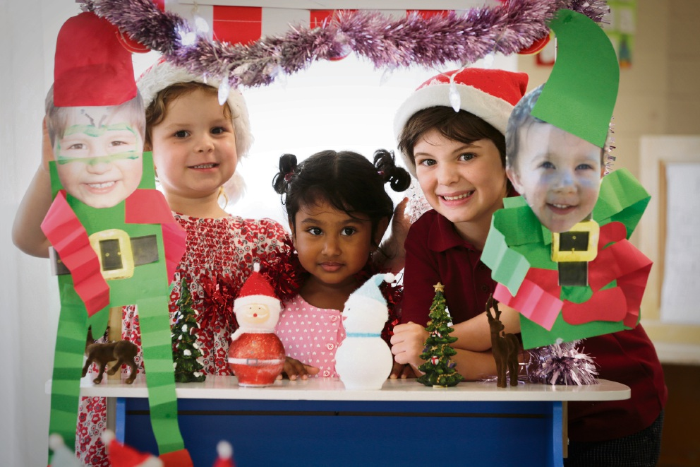 L-R Lucy Kitto (4), Annie Chacko (2) and Hayes Healy (5). The kids at Point Resolution Child Care enjoying their Christmas party Picture: Andrew Ritchie www.communitypix.com.au   d477291