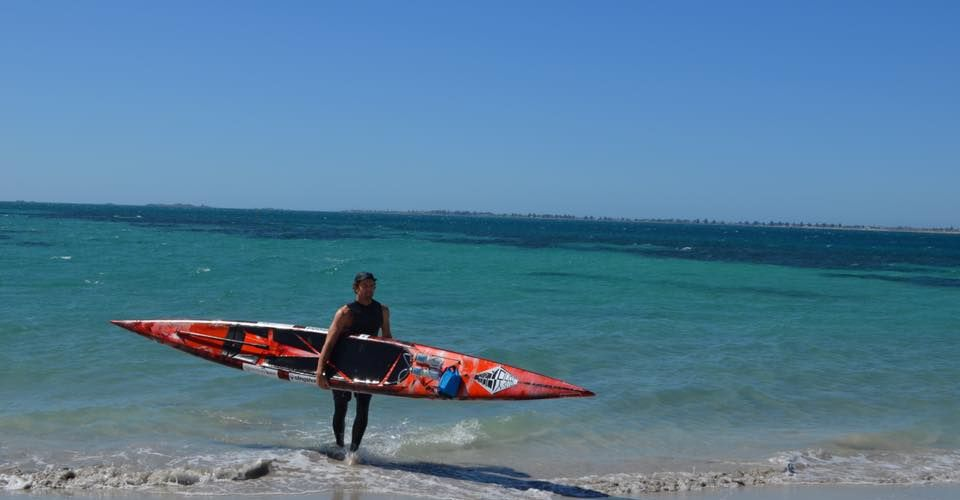 Guildford's Alex Fossilo is kneeling on his board and paddling with his hands from Dunsborough to Fremantle for charity.