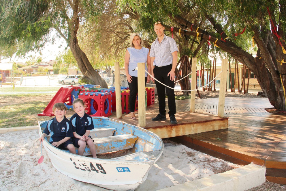 Beaumaris Primary School deputy principal Rebekah Brand and Beaumaris IGA store manager Scott Crowley with students Charlie Unwin and Zoey Snyder.
