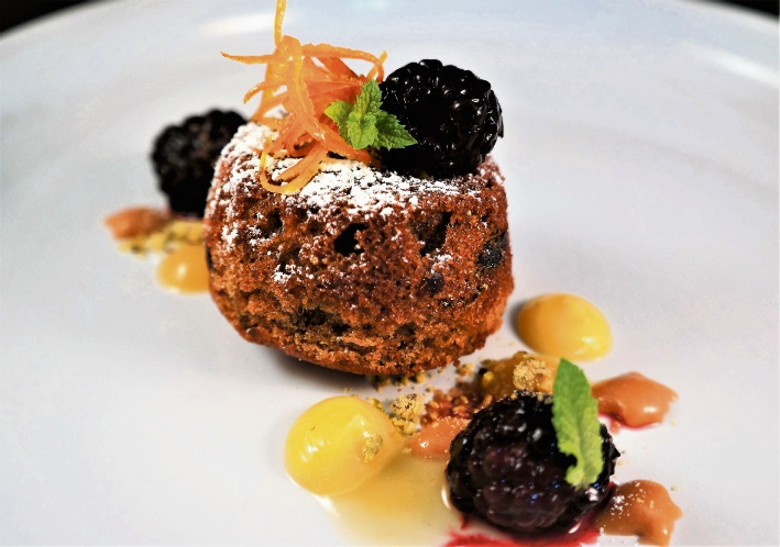 Recipe: Warm Medjool date pudding with salted caramel, lemon curd, fresh mulberries and pistachios
