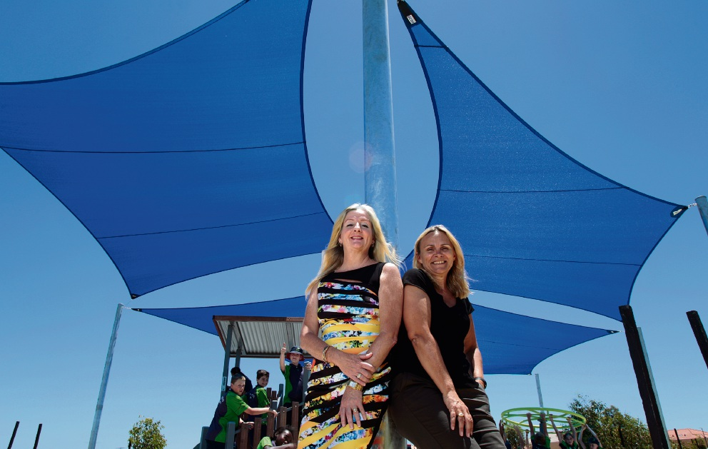 City of Wanneroo Mayor Tracey Roberts and Sabine Winton MLA Member for Wanneroo are checking out the new shade sails installed at Salitage Park in Pearsall. Enjoying the playground in the background are students from Pearsall Primary School. Picture: Marie Nirme d477394