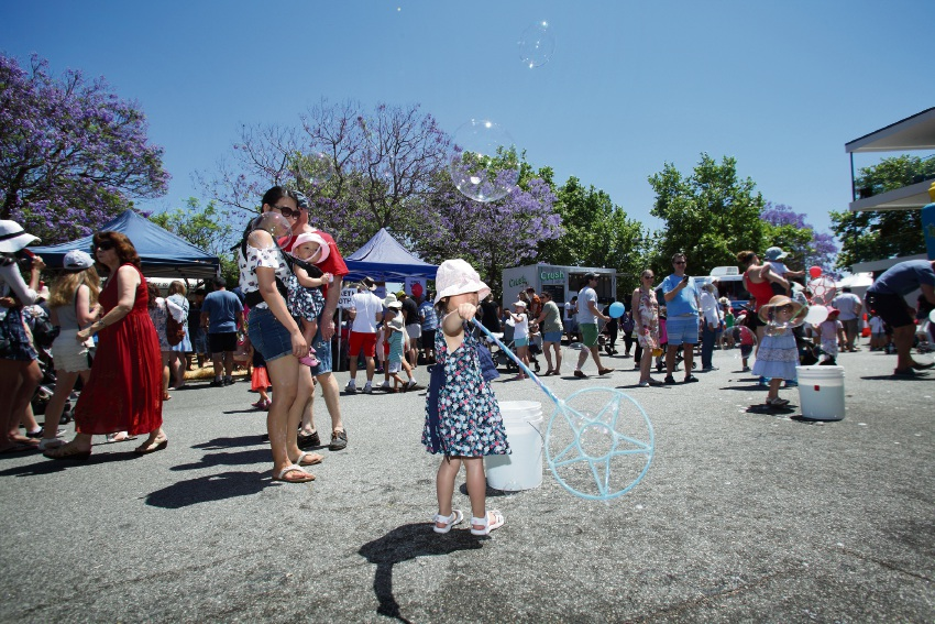 A young girl enjoys the sunshine at the Rotary Jacaranda Festival. Picture: Nicole Symons