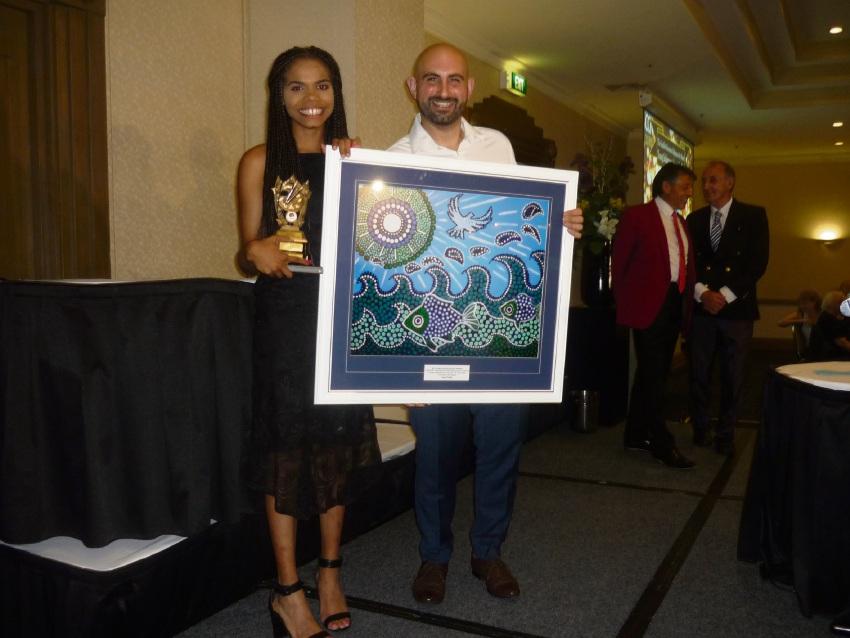 Taya Parfitt receives her Young Australian Indigenous Artist of the Year award.