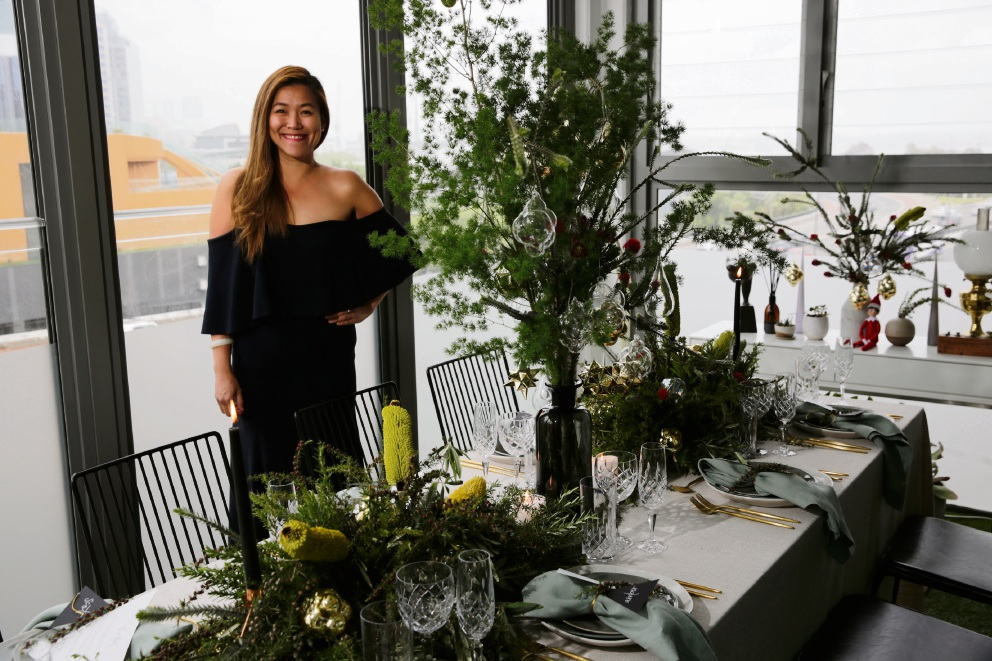 Michelle Mok with her beautifully styled Christmas table. Chairs, napkins, glassware and crockery from Hire Society.