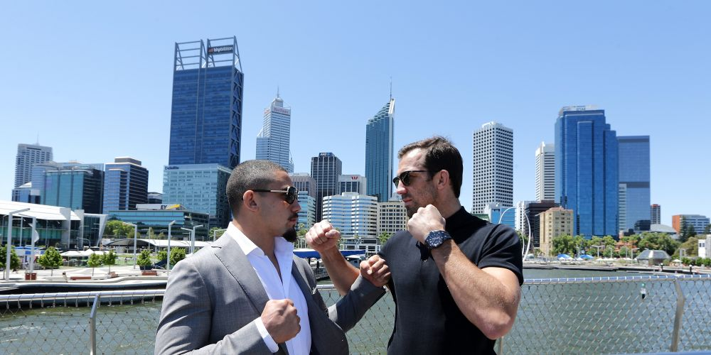 Australia's inaugral UFC champion Robert Whittaker and American contender Luke Rockhold pose at Elizabeth Quay after a press conference  in Perth today. Picture: Will Russell/Getty Images