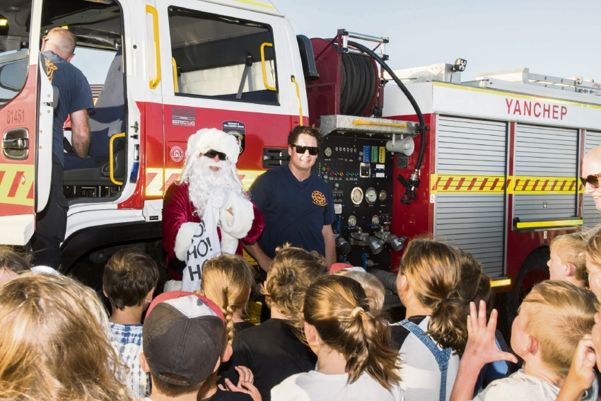 Santa accompanied by the Yanchep Volunteer Fire and Rescue.
