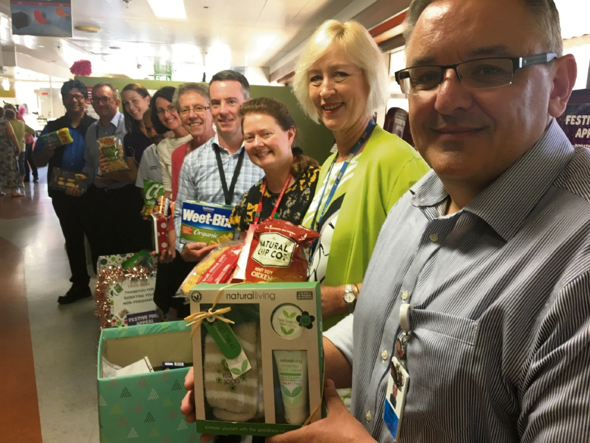SCGH executive director Tony Dolan (front) with hospital executive and service staff, along with Foodbank's Janie Brackenridge (third from back).