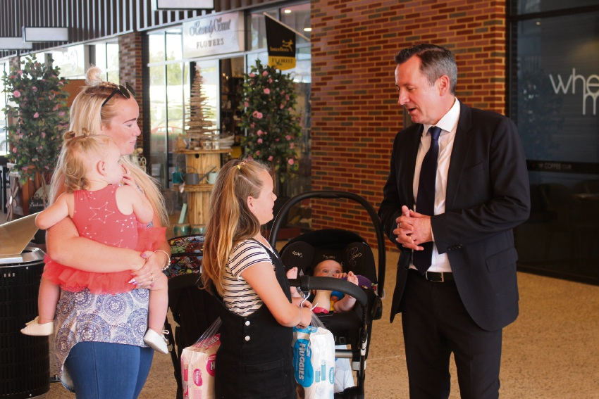 Premier Mark McGowan speaking to (L-R) Sam Edwards, Coco Edwards (1, in her mother's arms), Kheelee Edwards (7) and Huxley Edwards.