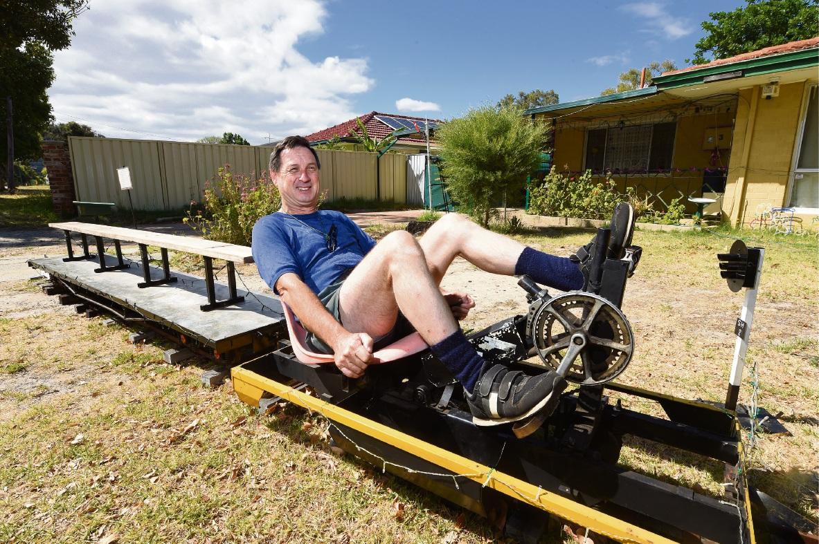 Kevin Bradney on his pedal-powered train. Picture: Jon Hewson www.communitypix.com.au d477592