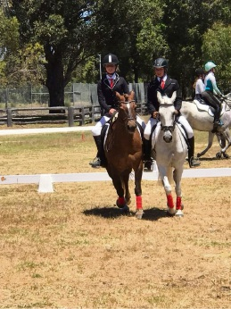 Keely Bowling on Buzz and Selina Vogel on Missy completing a pairs dressage test at our wind up camp this year.