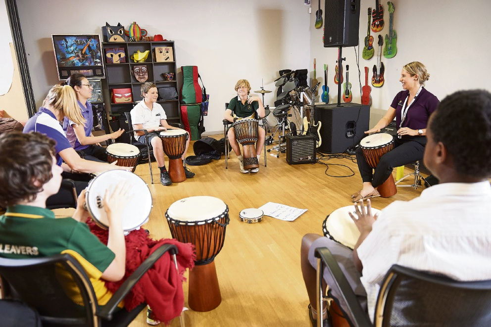 Local teenagers participating in a Drumbeat session at  Therapy Focus.
