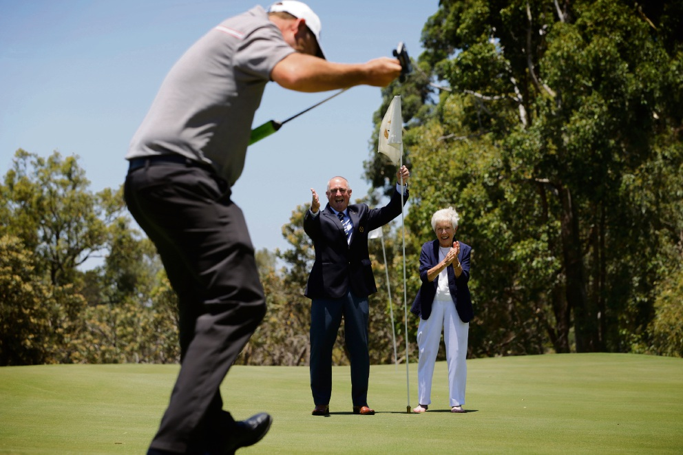 Putting for the hole is Duncam Kegg (Head Golfer Pro) with Mt Lawley Golf Club president David Crispin and life member Marie Westlake on the new hole. Picture: Andrew Ritchie d477570