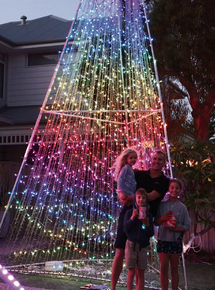 Kane Bullen with children Allegra (11), Hamish (8) and Rachel (5) with their Christmas lights display.