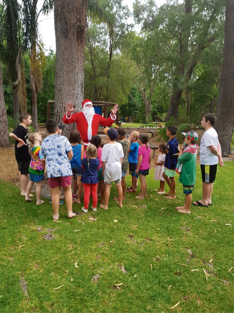 Santa with children at the 'fun day out'.