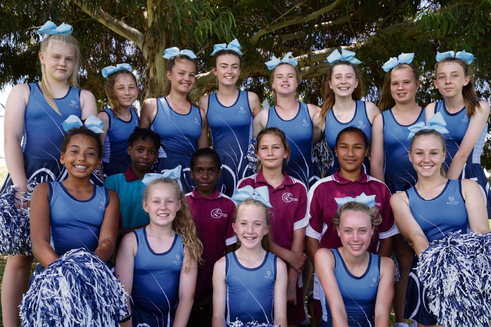 Butler College cheerleaders with Merriwa Primary School Year 6 students Elizabeth Niyibhigira, Ilana Dimer-Narkle, Vanessa Williams and Olivia Rowlands. Picture: Martin Kennealey d477491