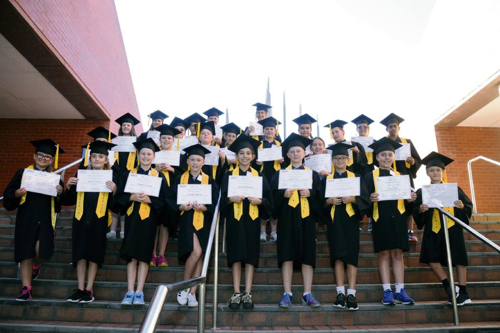 Bright futures: Graduates of the Children's University ECU program get a taste of success.